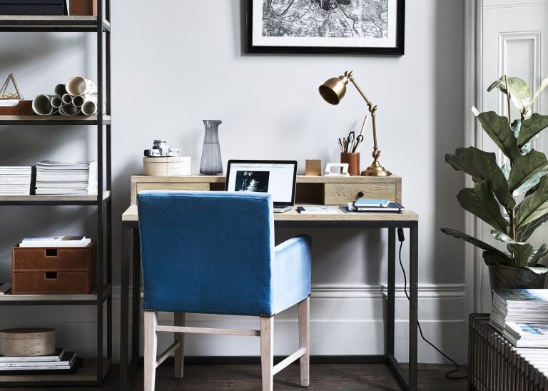 blue chair in front of desk with laptop